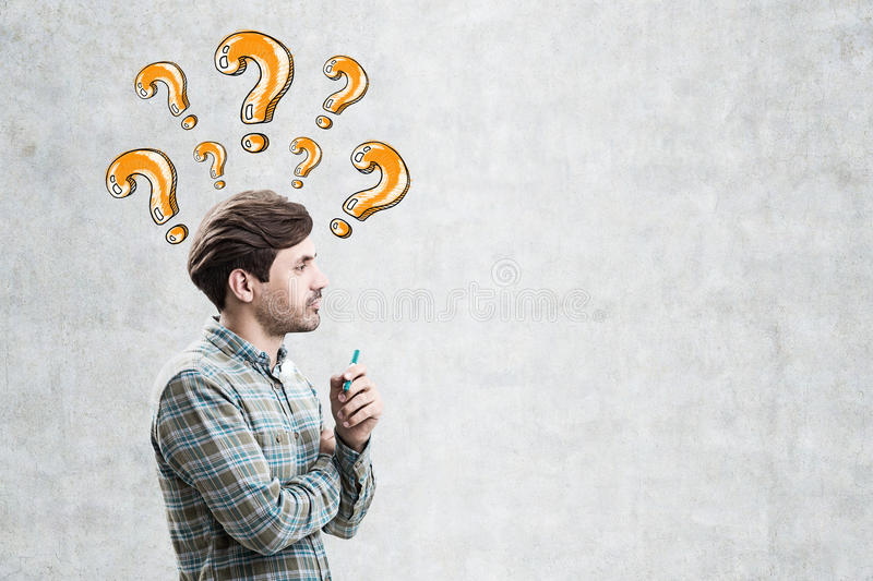 Man in green and orange question marks royalty free stock photo