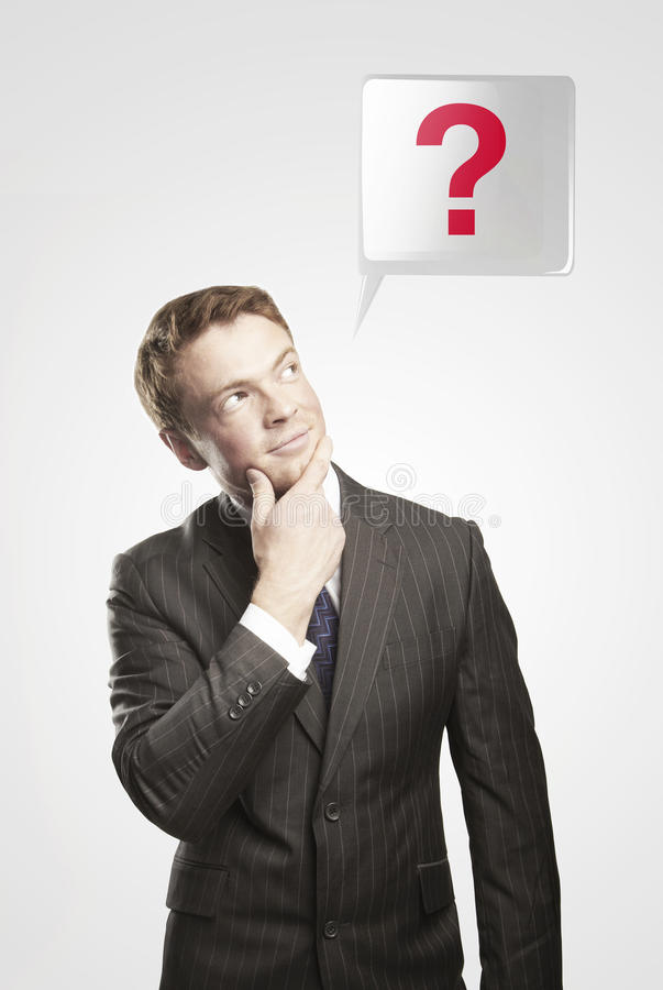 Man With Green Question Mark Above His Head Royalty Free Stock Photography