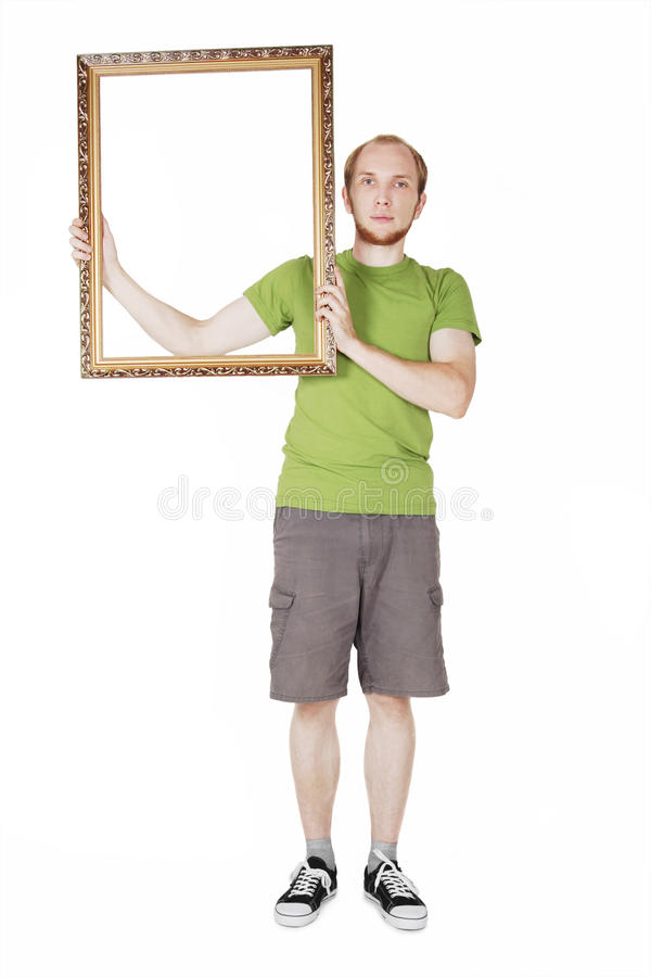 Man in green shirt holding  picture frame