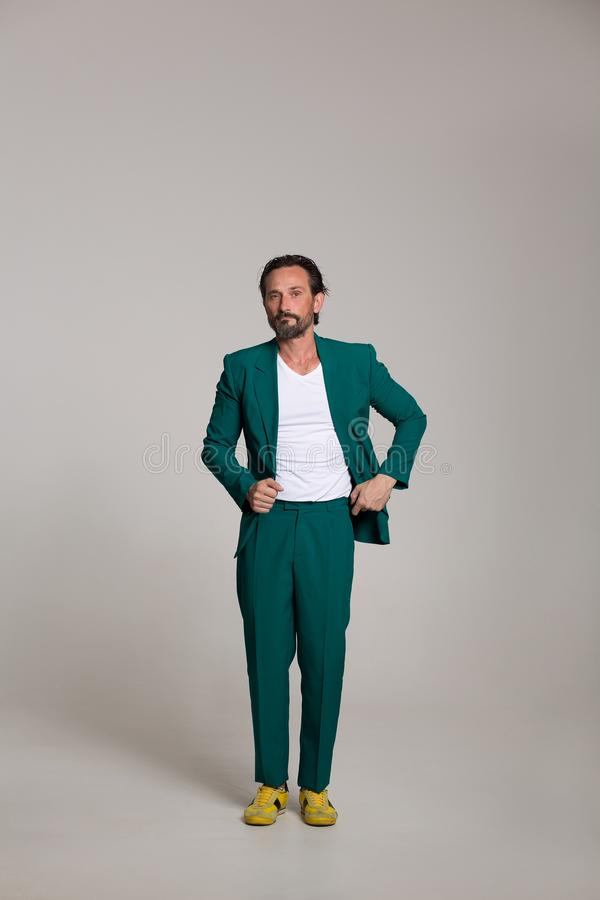Handsome man in green suit. Man in green suit and whit T shirt. Posing on camera stock image