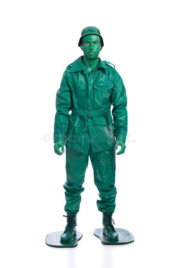 Man on a green toy soldier costume. Isolated on white background royalty free stock image