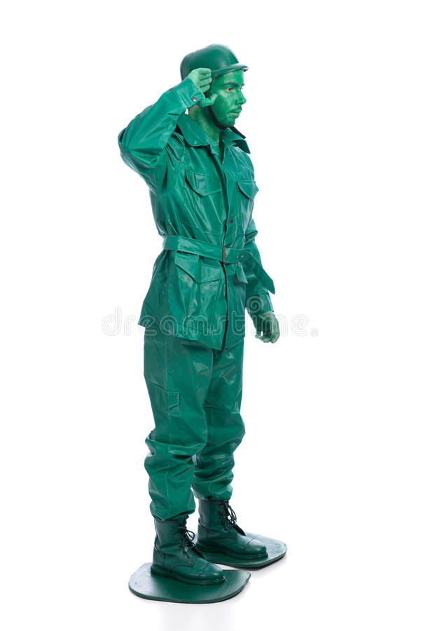 Man on a green toy soldier costume. Saluting isolated on white background stock photography