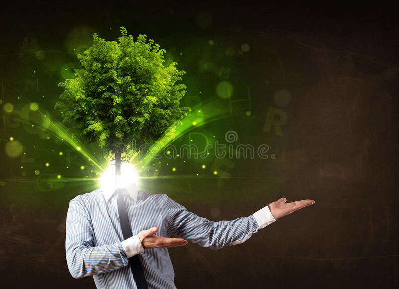Man with green tree head concept. On brown background stock photos
