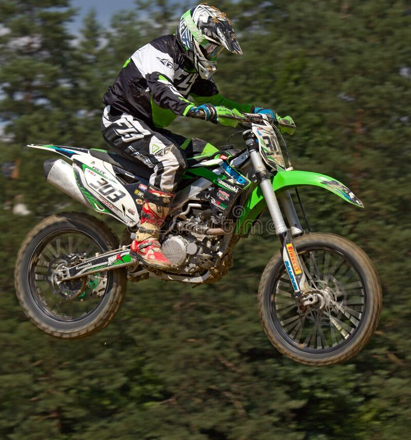 Man In Green White And Black Mtx Suit On Green And White 303 Dirt Motorcycle In The Air Free Public Domain Cc0 Image