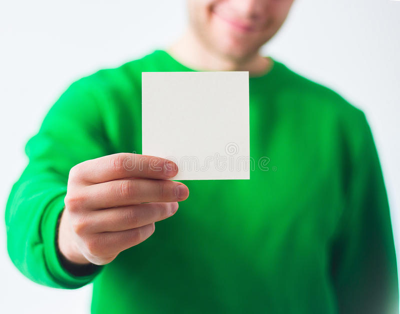 Man in greenery sweatshirt smile, Hand holding Blank A4 Flyer, D. L, A5, square, Invitation, brochure booklet, pamphlet, fold offset paper, design, mock up royalty free stock images