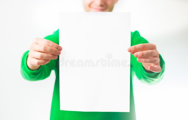 Man in greenery sweatshirt smile, Hand holding Blank A4 Flyer, D. L, A5, square, Invitation, brochure booklet, pamphlet, fold offset paper, design, mock up stock photo