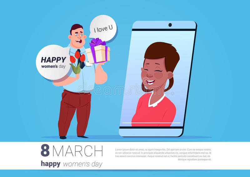 Man greeting girl white international women day online with smart download man greeting girl white international women day online with smart phone holding flowers and present m4hsunfo