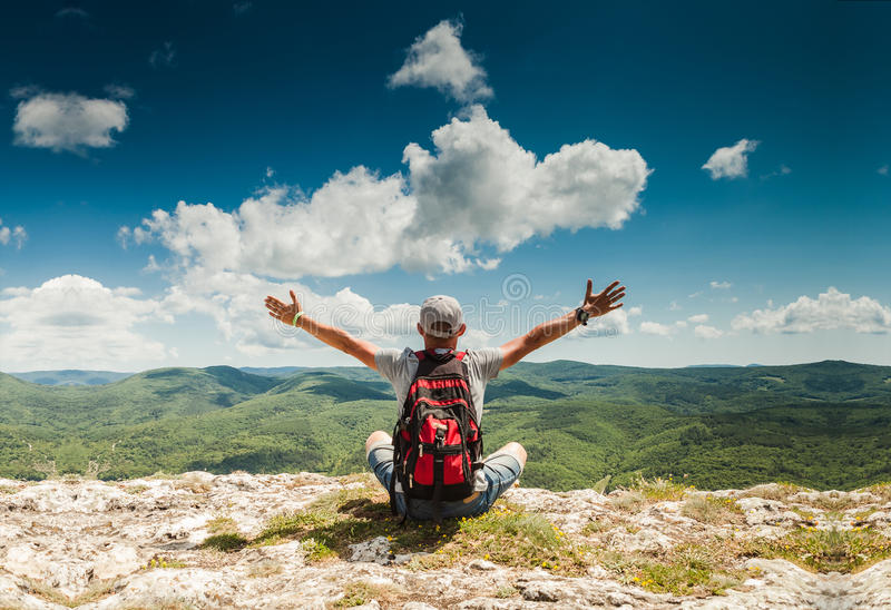 Man greeting nature on the top of mountain royalty free stock image