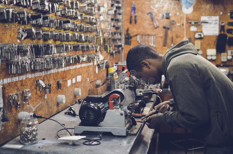Man In Grey Hoodie Jacket Holding Black Metal Near White Socket Power Supply Free Public Domain Cc0 Image