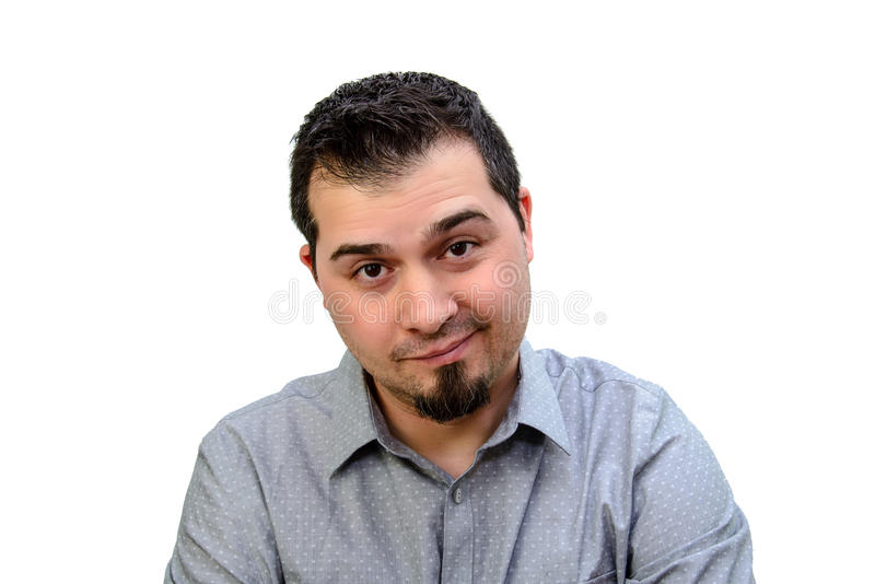Man in Grey Shirt looking skeptical on white backdrop stock photo