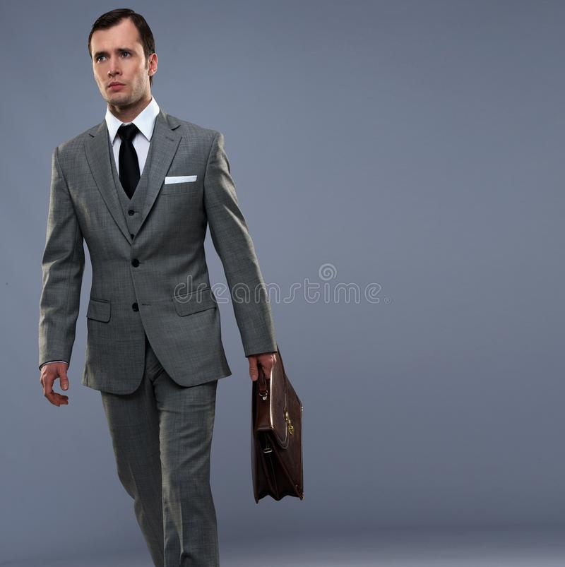 Download Man in grey suit walking stock photo. Image of isolated - 27592022