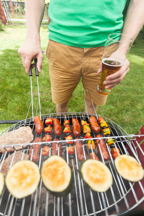 Free Man Grilling Food Royalty Free Stock Photo - 54962235