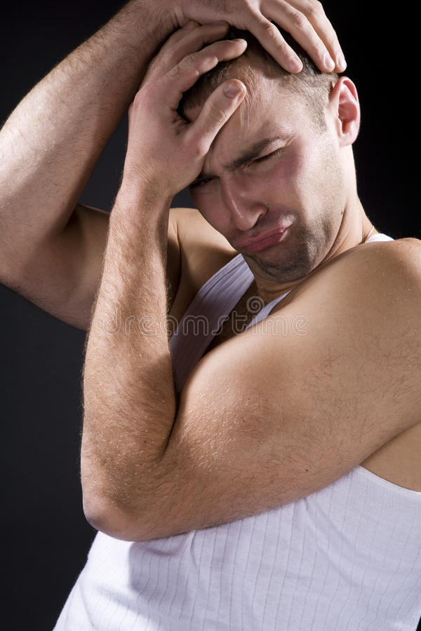 Man grimacing. On a black background stock photos