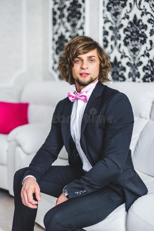 Man the groom in a wedding formal costume. Man the groom in a wedding formal costume with butterfly royalty free stock photo