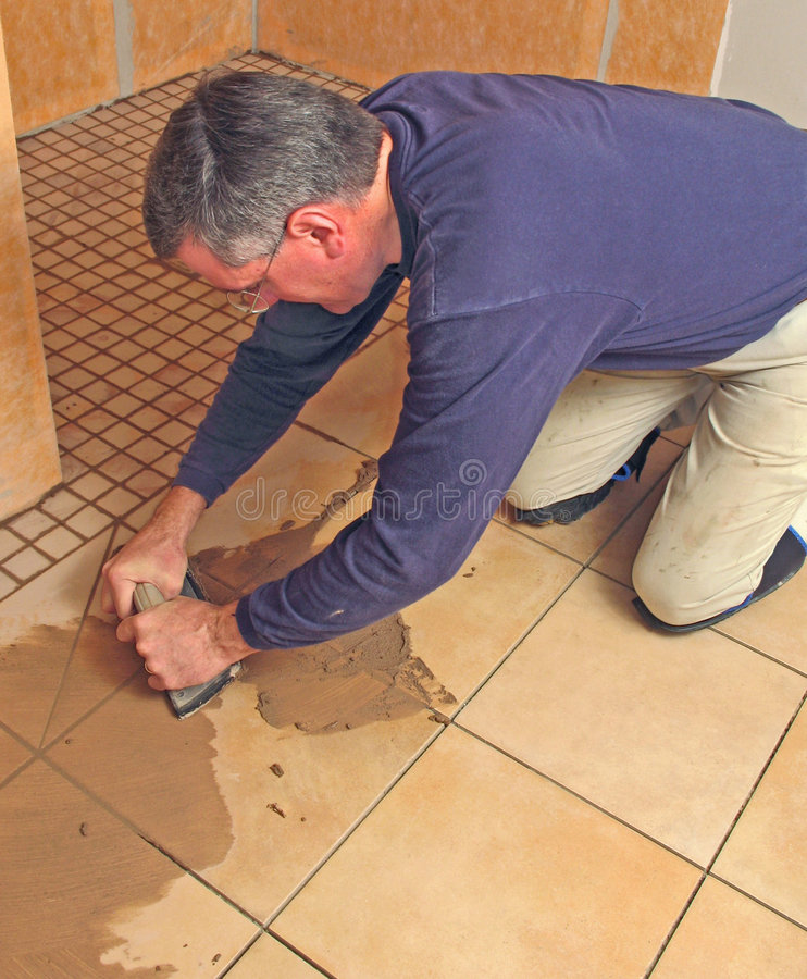 Man Grouting A Ceramic Tile Floor Stock Image Image Of Install