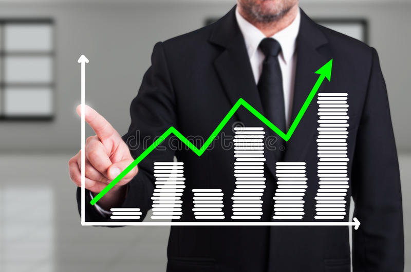 Man with growth chart business diagram on digital screen. Wearing a suit as progress and economic achievement concept stock images