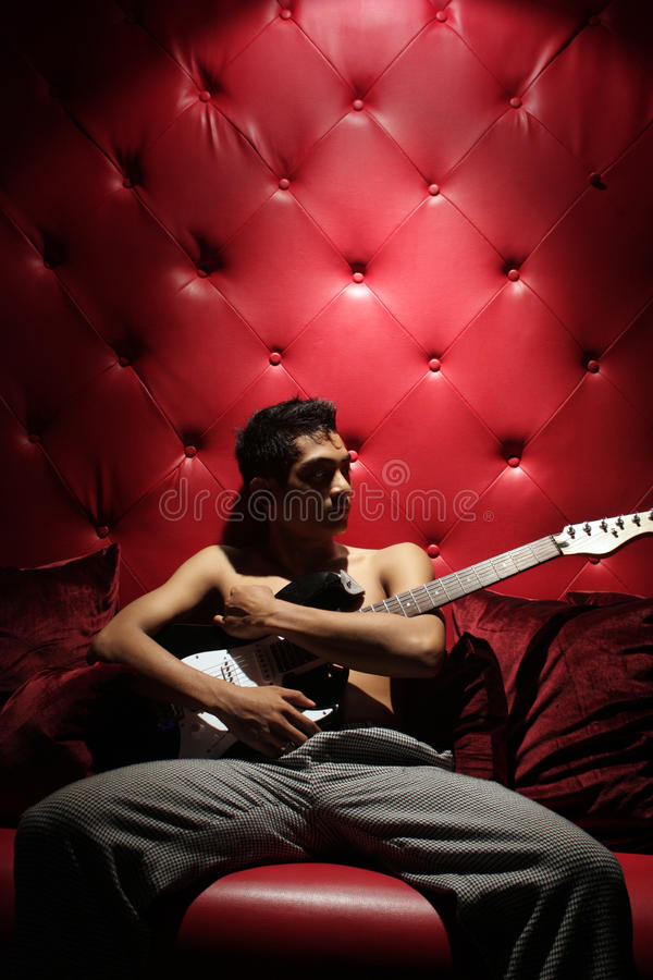 Man and guitar stock photo