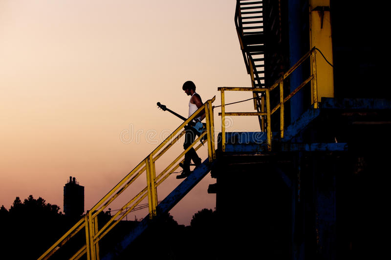 Download Man with guitar at dusk stock photo. Image of dusk, slim - 20814274