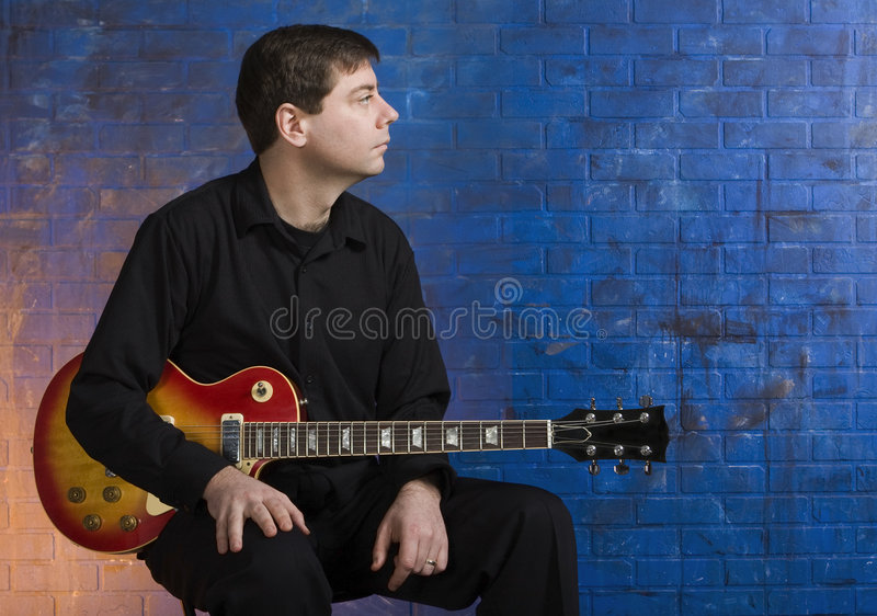 Man with Guitar on Lap stock image