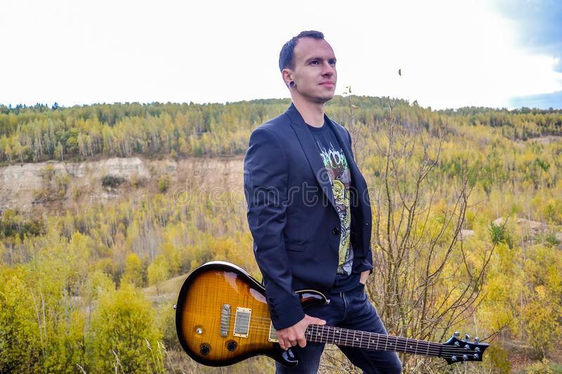 Man with a guitar royalty free stock photo