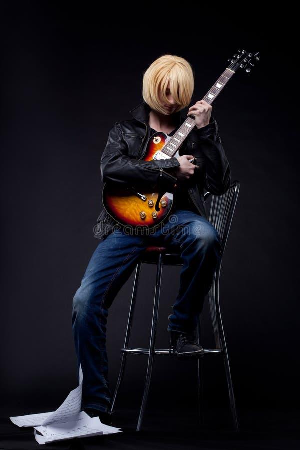 Man Guitar Player Cosplay Anime Character Stock Photo