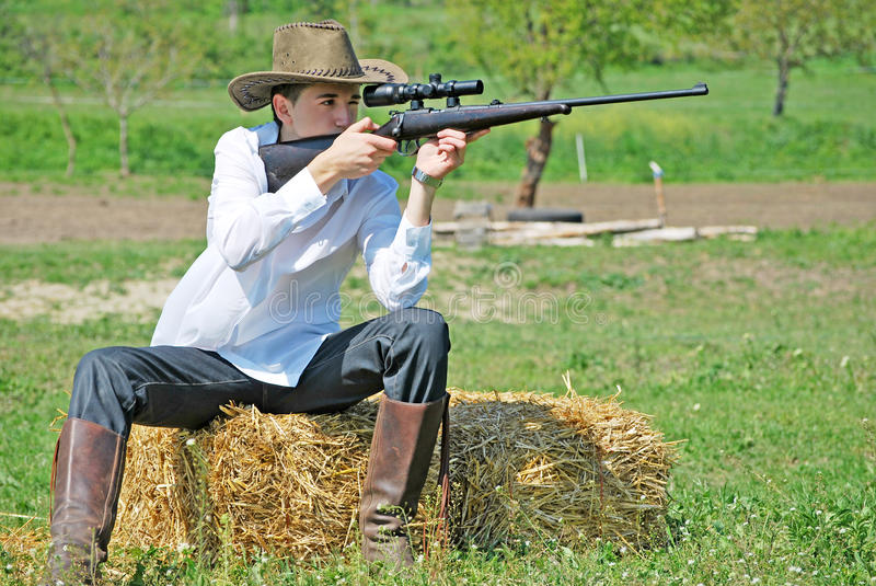 Download Man with a gun stock photo. Image of field, country, agriculture - 14216770