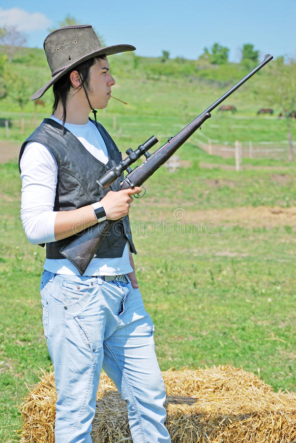 Download Man with a gun stock photo. Image of pose, aiming, bale - 14434986