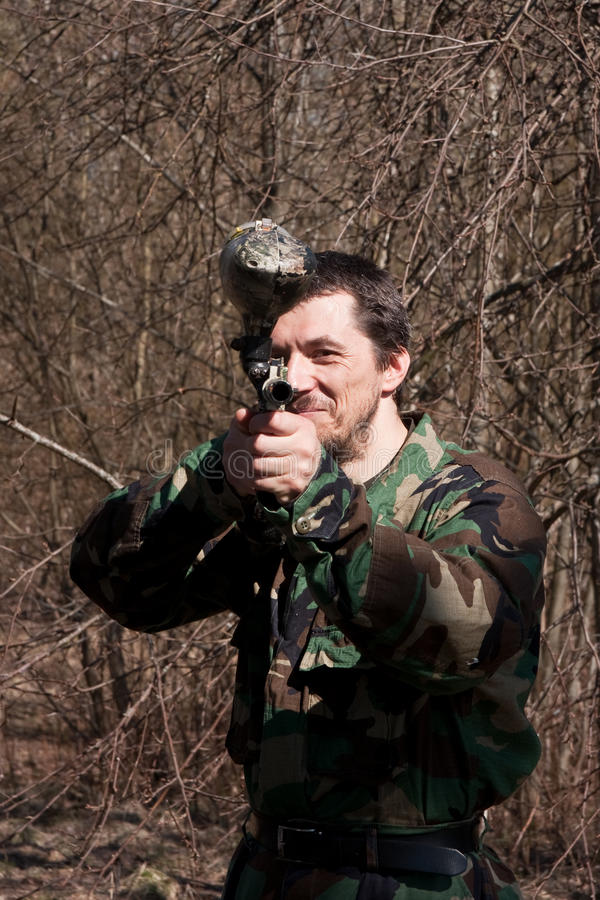 The man with a gun for paintball royalty free stock photo