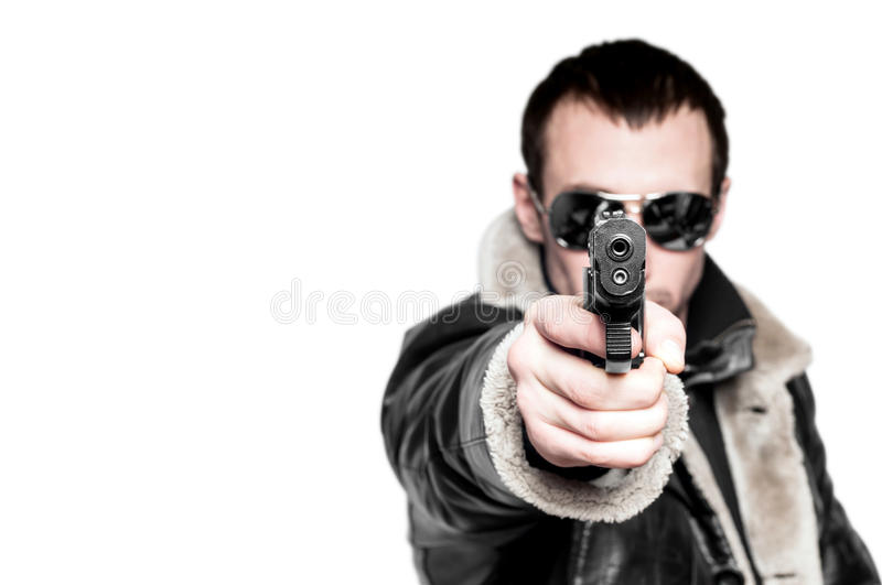 Man with gun in sunglasses. stock image