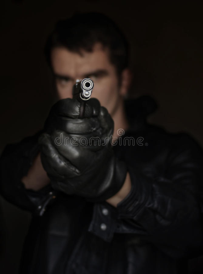 Man with a gun royalty free stock photos