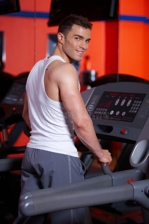 Download Man at the gym stock photo. Image of health, machine - 14855328