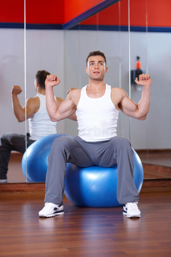 Download Man at the gym stock image. Image of train, body, machine - 14855531