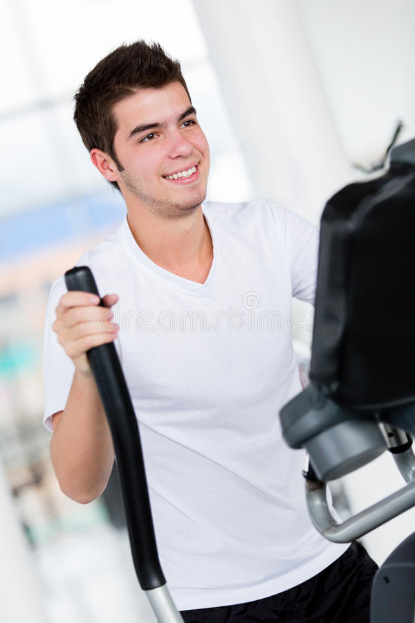 Download Man at the gym stock photo. Image of exercising, attractive - 25864028