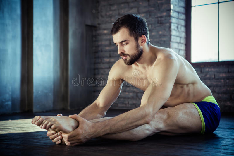 Man at the gym doing stretching royalty free stock photo