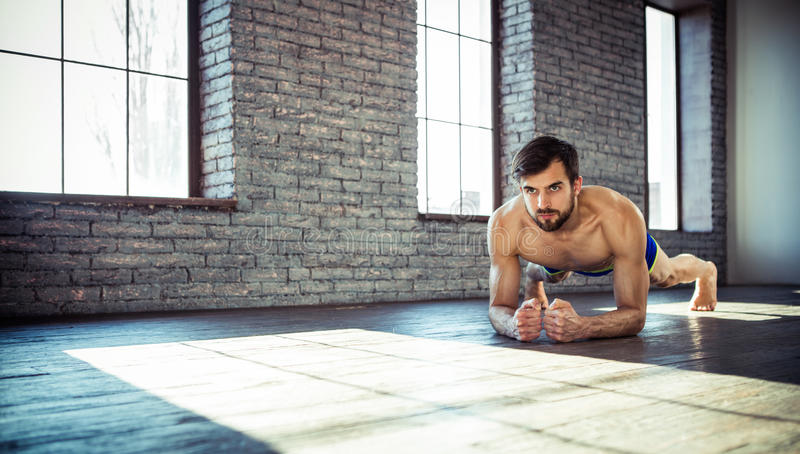 Man at the gym doing stretching royalty free stock images