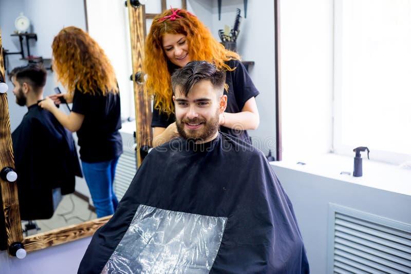 Man at a hair salon stock images