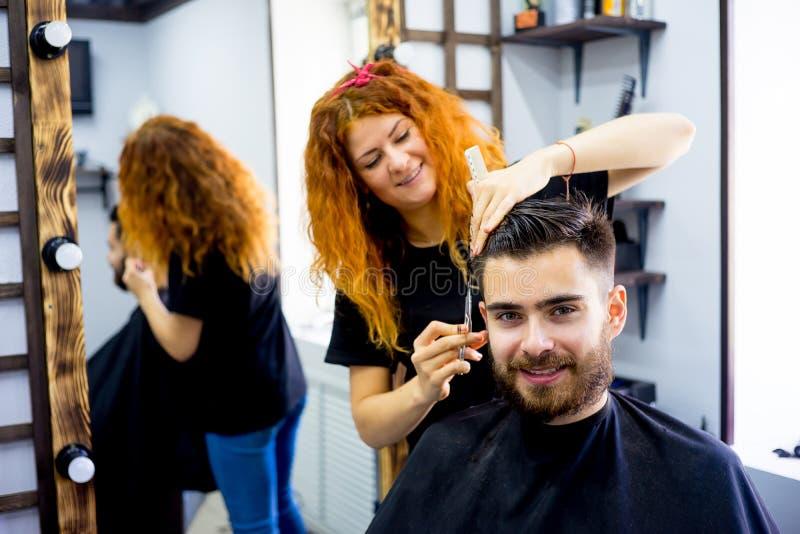 Man at a hair salon stock photos