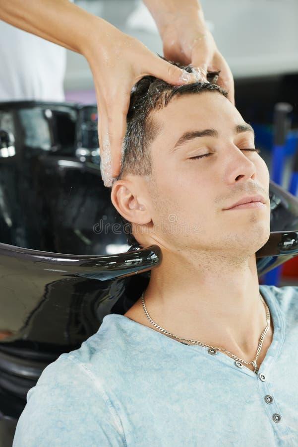 Man hair washing in hairdressing salon royalty free stock photo