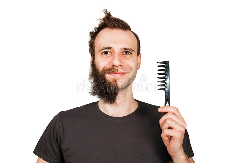 Man with half shaved beard surprised with smile hold hair comb. Isolated on white background. Man with half shaved beard surprised with smile hold hair comb royalty free stock photos