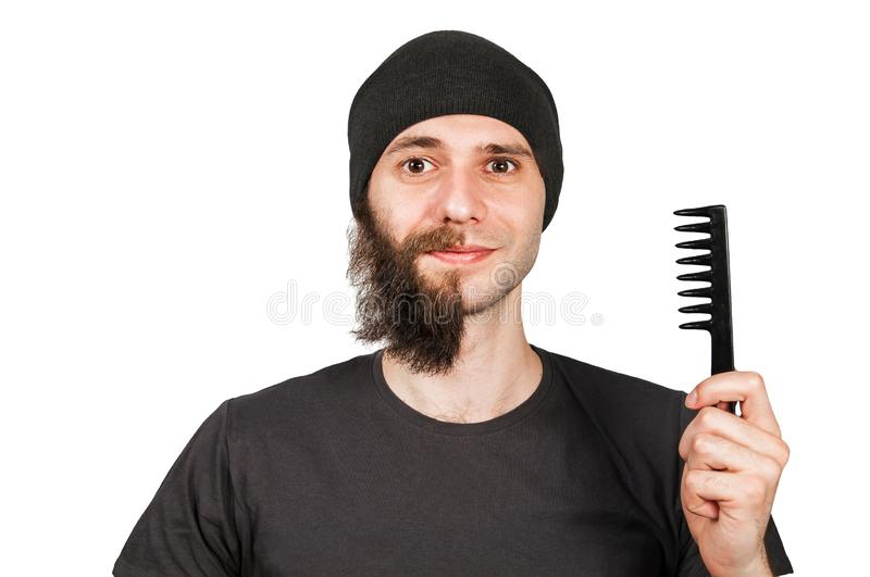 Man with half shaved beard surprised with smile hold hair comb. Isolated on white background. Man with half shaved beard surprised with smile hold hair comb stock photography