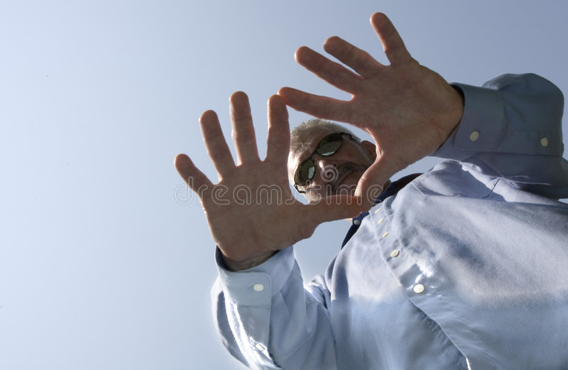 Man in hand stock image