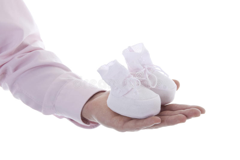 Man hand with baby shoe royalty free stock image