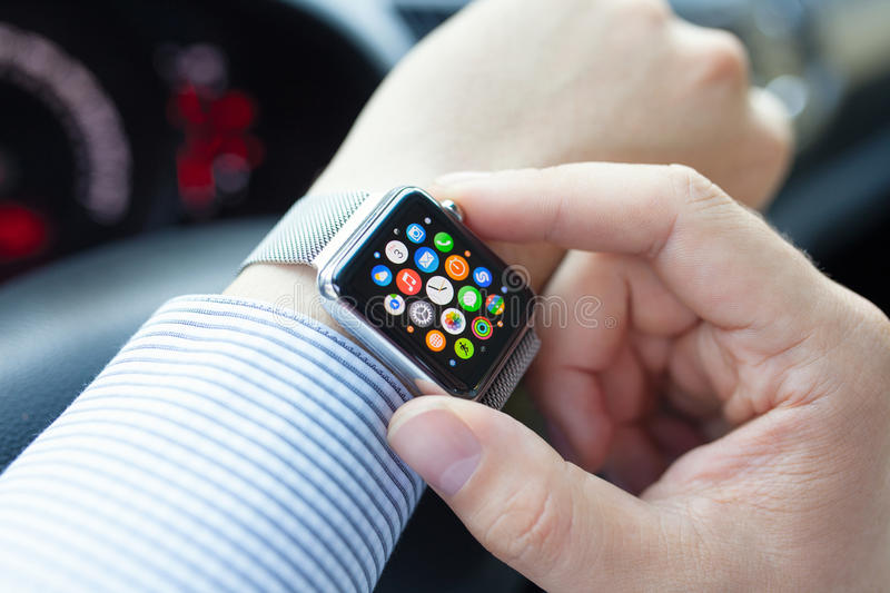 Man hand in the car with Apple Watch and Icon royalty free stock images