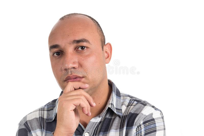Man with hand on chin. Latin American hairless, isolated on whit stock photo