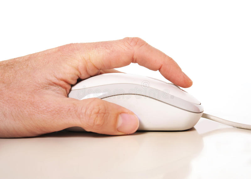 Man hand and computer mouse. Man hand operating computer mouse isolated on white background royalty free stock image