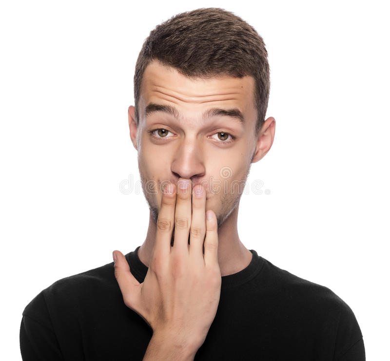 Man with hand covering his mouth. stock photography