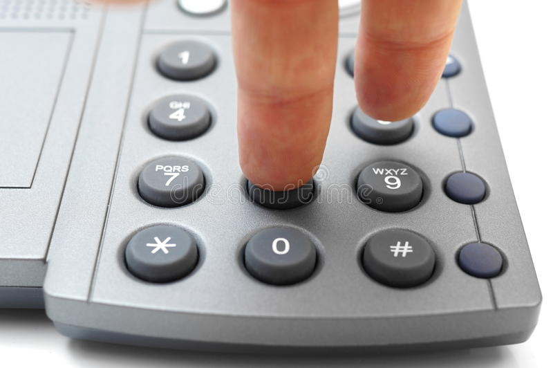 Man hand is dialing a telephone number.  stock photography