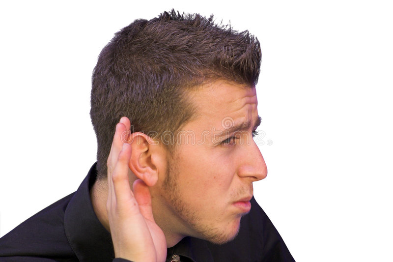 Man with hand on ear