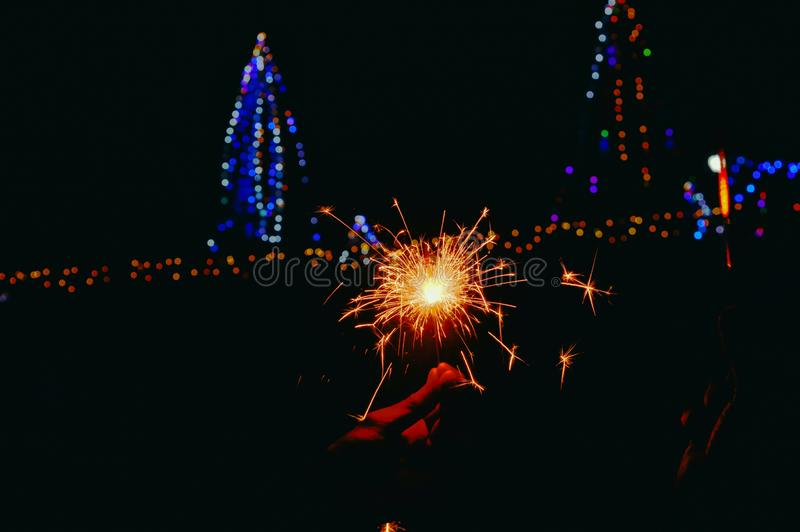 man hand firewrks Close up view,happy birthday, night party ,happy diwali,Man's hand holds sparklers, Happy New Year, Glowing stock photography