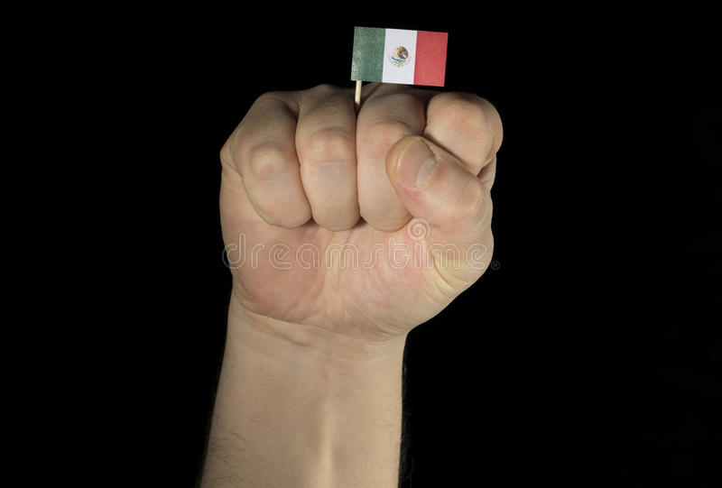 Man hand fist with Mexican flag isolated on black background royalty free stock photo